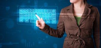 Girl pressing virtual type of keyboard. Young girl pressing virtual type of keyboard Stock Photography