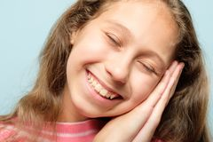 Girl pretend sleep hands smiling facial expression stock photography