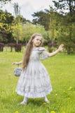 Girl pretending princess almost blown away Stock Photo