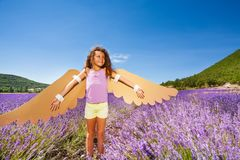 Girl pretending to be a bird in handmade costume. Funny girl pretending to be a bird, standing in lavender field in her handmade costume Stock Images