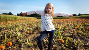 Girl pretending to be a scarecrow Royalty Free Stock Photography
