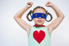 Girl pretending to be a superhero. Portrait of girl pretending to be a superhero Stock Photo