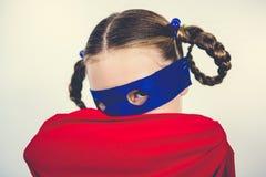 Girl pretending to be a superhero. Portrait of girl pretending to be a superhero Royalty Free Stock Photo
