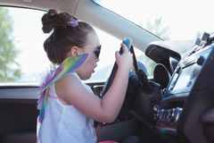 Girl pretending to drive a car Royalty Free Stock Images