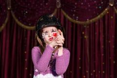 Girl pretending to have a gun in a conceptual play Stock Photography