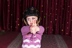 Girl pretending to shoot the enemy Royalty Free Stock Photo