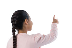 Girl pretending to touch an invisible screen Royalty Free Stock Photo