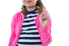 Girl pretending to touch an invisible screen Royalty Free Stock Photos
