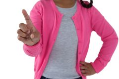 Girl pretending to touch an invisible screen against white background Stock Images