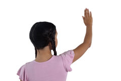 Girl pretending to touch an invisible screen against white background Stock Photos