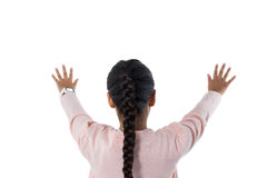 Girl pretending to touch an invisible screen against white background Royalty Free Stock Images