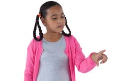 Girl pretending to touch an invisible screen Stock Image