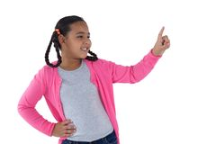 Girl pretending to touch an invisible screen Stock Photo