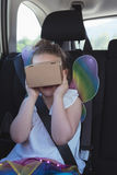 Girl pretending to use virtual reality headset. In car Royalty Free Stock Photography