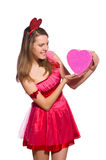 Girl in pretty pink dress with gift box isolated Royalty Free Stock Photos