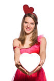 Girl in pretty pink dress with gift box isolated Royalty Free Stock Photography