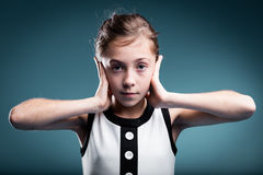 Girl preventing herself to hear Stock Photography