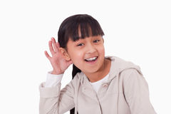 Girl pricking up her ear. Against a white background royalty free stock image