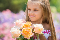 Girl princess in a beautiful dress holding a bouquet of roses Royalty Free Stock Photos