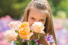 Girl princess with a bouquet of roses Royalty Free Stock Photography