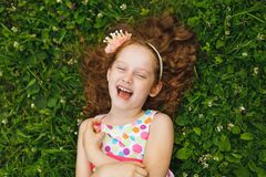 Girl with princess crown lying on the grass Stock Images