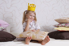 Girl in princess crown at pyjamas party Royalty Free Stock Image