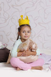 Girl in princess crown at pyjamas party Royalty Free Stock Images