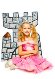 Girl in princess dress and her cardboard castle Stock Photo