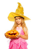 Girl in princess dress hold Halloween pumpkin Royalty Free Stock Photography