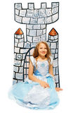 Girl in princess dress sit near cardboard castle Royalty Free Stock Photo
