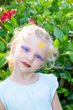 Girl with princess face painting Stock Images