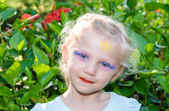 Girl with princess face painting Royalty Free Stock Photos