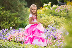 Girl Princess in the garden flower bed Stock Photography