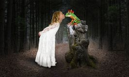 Girl, Princess, Kiss, Kissing Frog, Fantasy. A young girl princess is kissing a frog that will turn into a handsome prince. The magic of love and a kiss can turn Royalty Free Stock Photography