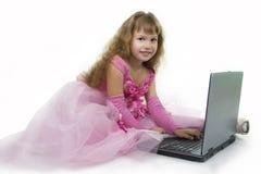 Girl princess and notebook. Royalty Free Stock Photo