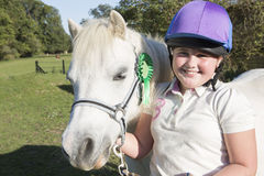 Girl With Prize Winning Pony In Field Royalty Free Stock Photos