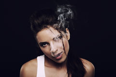 Girl producing  smoke Stock Images