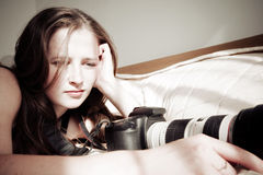 Girl with professional camera Royalty Free Stock Image