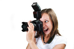 Girl with professional digital camera isolated on white background Royalty Free Stock Photography