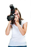 Girl with professional digital camera isolated on white background Stock Image