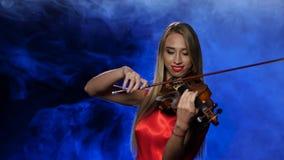 Girl professional fiddler playing the viola. Studio. Smoke stock video