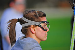 Girl profile. Profile of a girl high school girls lacrosse player wearing gogles and a pony tail stock photos