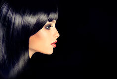 The girl in profile with black straight shiny hair. Royalty Free Stock Images