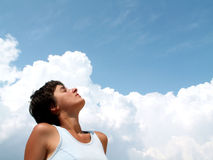 Girl profile on blue sky. Girl on white clouds and blue sky looking to the future royalty free stock image