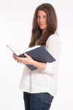 Girl in profile with book Royalty Free Stock Photos