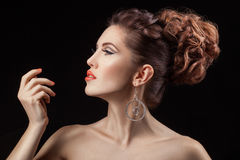 Girl in profile with a coral lip color. Stock Images