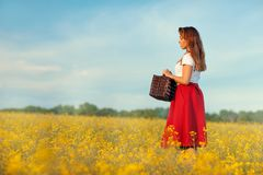 Girl profile on a yellow meadow. Stock Images