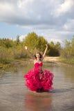 Girl prom dress jumping Stock Photo