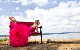 Girl prom dress laying on bench Royalty Free Stock Images