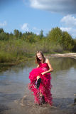 Girl prom dress splashing water Stock Photos